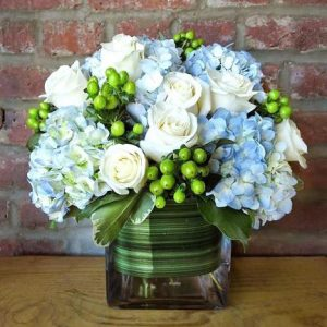 Floral Arrangement with White Roses, Blue Hydrangeas and Green Hypernicum